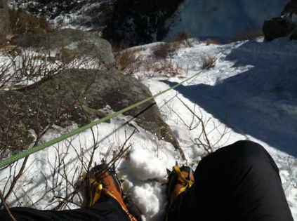 Belaying from the snow field in Odell's Gully
